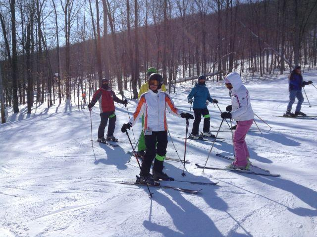 Skiers on the slope at Bristol Mountain